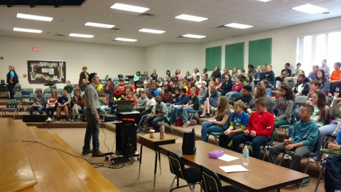 Discussing paleontology and causes of global warming with 5th and 6th graders. (Photo by Rebecca Musso)